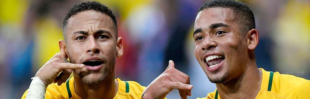 Die besten Online Sportwetten Close-up zwei Fussballspieler geben Handzeichen