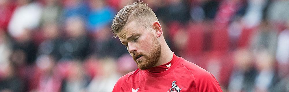 Die besten Online Sportwetten Close-up Fussball Torhüter auf Spielfeld FC Köln