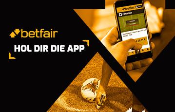 Die besten Online Sportwetten betfair hol dir die App Fussballrasen Markierung mit Fussball Hand mit smartphone