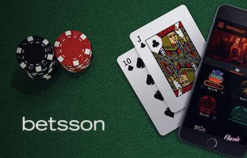 Die besten Online Casino Spiele betsson Pokerchips und Pokerkarten mit smartphone auf Tisch