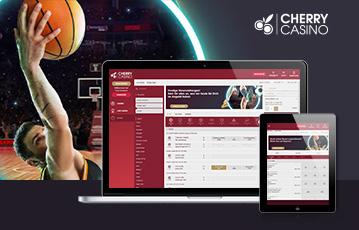 Die besten Online Sportwetten cherry casino screen tablet smartphone Basketballspieler mit Ball in Hand im Spiel