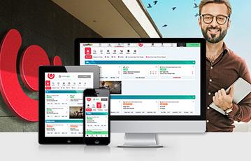 Die besten Online Sportwetten Desktop Laptop smartphone screen guts lächelnder Mann mit tablet in Hand
