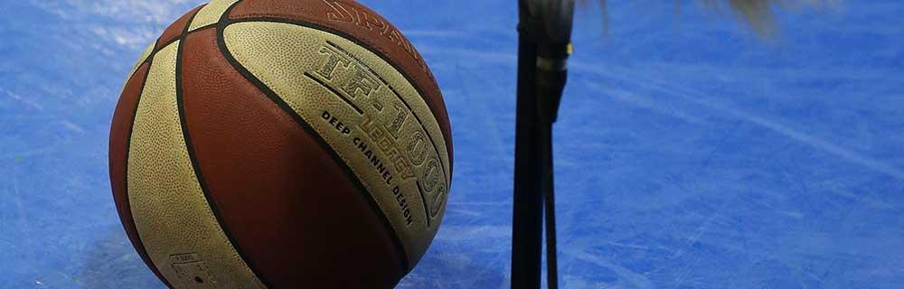 Die besten Online Sportwetten Close-up Basketballauf dem Spielfeld