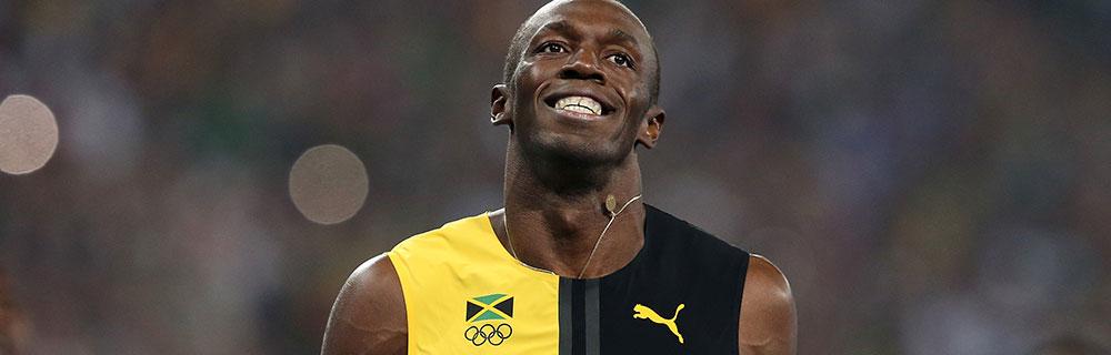 Die besten Online Sportwetten Close-up Fussballspieler Bolt Freude auf dem Spielfeld