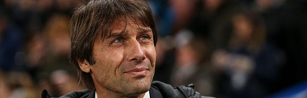 Die besten Online Sportwetten Close-up Gesicht lächelnder Fussballtrainer Chelsea Conte