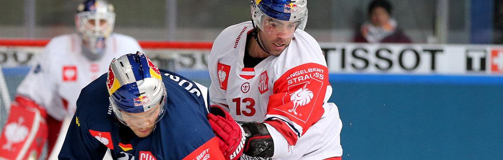 Die besten Online Sportwetten Close-up zwei Eishockeyspieler auf dem Eis Duell