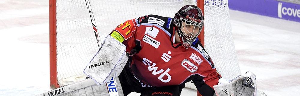 Die besten Online Sportwetten Close-up Eishockeyspiel Torhüter vor Tor