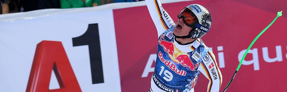 Die besten Online Sportwetten Close-up Skiläufer Thomas Dressen im Lauf einen Arm nach oben