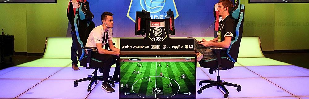 Die besten Online Sportwetten zwei Gamer in Arena Bildschirm fifa Spiel