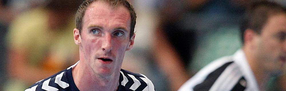 Die besten Online Sportwetten Close-up Handballspieler auf dem Spielfeld