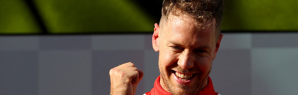 Die besten Online Sportwetten Close-up Formel 1 Rennfahrer Vettel Siegerpose