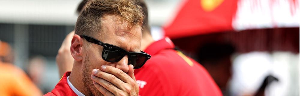 Die besten Online Sportwetten Close-up Formel 1 Rennfahrer Vettel Sonnenbrille Hand vor Mund