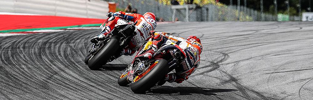 Die besten Online Sportwetten MotoGP close-up MotoGP Fahrer auf Rennstrecke in Kurve