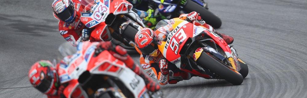 Die besten Online Sportwetten MotoGP close-up MotoGP Fahrer auf Rennstrecke