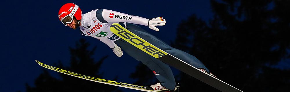 Die besten Online Sportwetten Close-up Skispringer im Flug