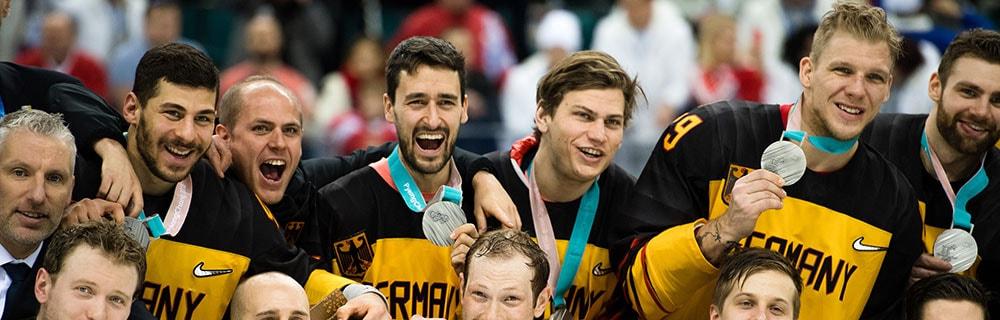 Die besten Online Sportwetten close up deutsche Mannschaft mit Medaillen
