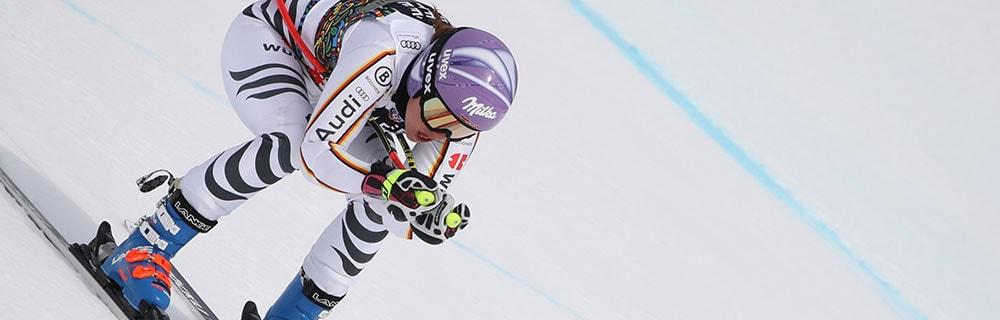 Die besten Online Sportwetten Close-up Skifahrerin Skiabfahrt
