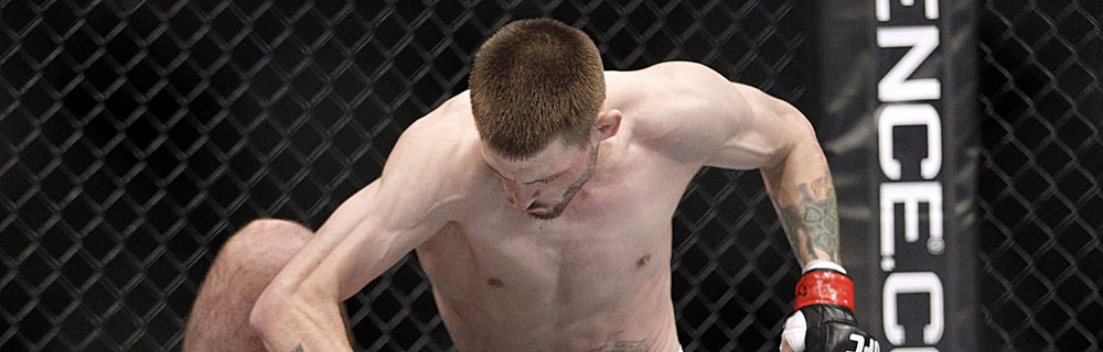 Die besten Online Sportwetten Close-up UFC Kämpfer im Kampf im Käfig