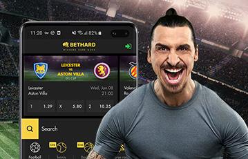 Die besten Online Sportwetten bei bethard live close up muskulöser Mann smartphone screen bethard livewetten